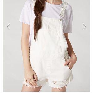 White distressed overalls